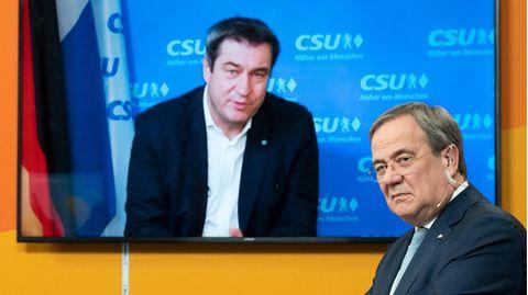 Markus Söder, CSU-Parteichef (im Hintergrund), und CDU-Parteichef Armin Laschet
