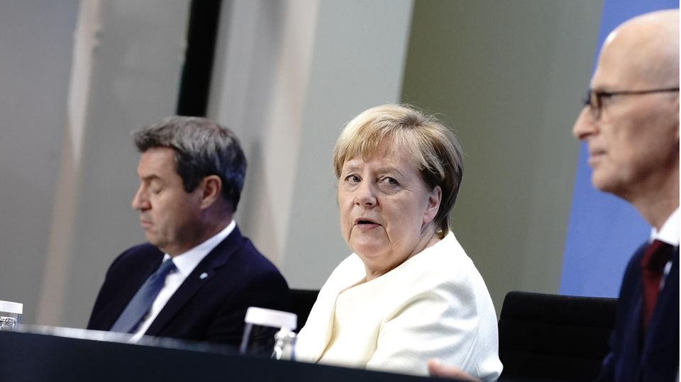 Bayerns Ministerpräsident Markus Söder, Bundeskanzlerin Merkel und Hamburgs Erster Bürgermeister Tschentscher