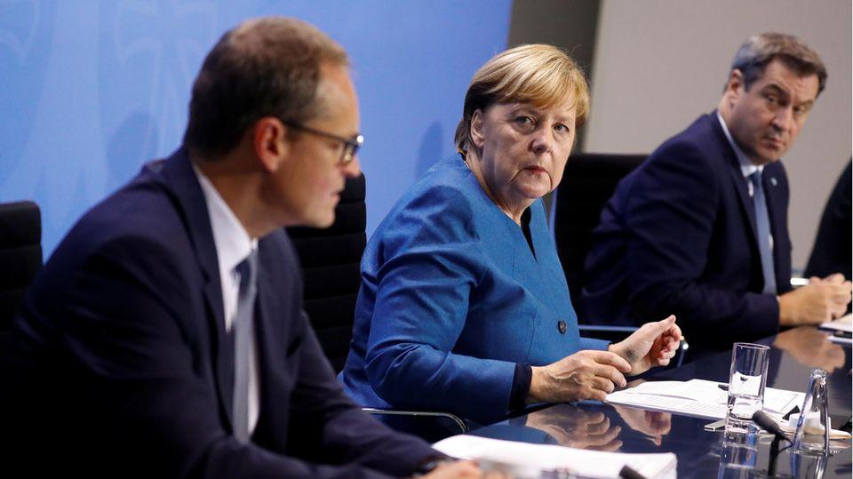Bundeskanzlerin Merkel, Bayerns Ministerpräsident Söder und Berlins Regierender Bürgermeister Müller