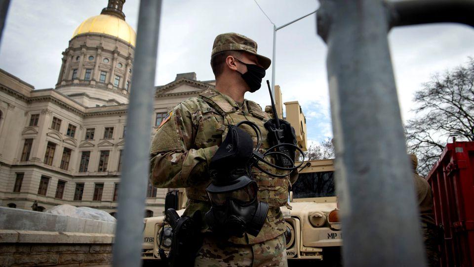 Washington : Geisterstadt und Kriegszone: Eindrücke aus einer Stadt an einem historischen Tag
