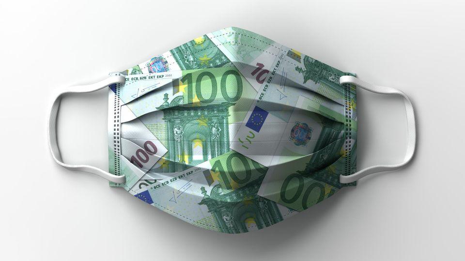 Eine Maske mit dem Motiv von Geldscheinen