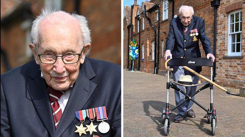 Ein weißhaariger alter Mann mit Halbglatze und Schnauzbart mit drei Orden am dunkelblauen Jacketts geht mit einem Gehwagen