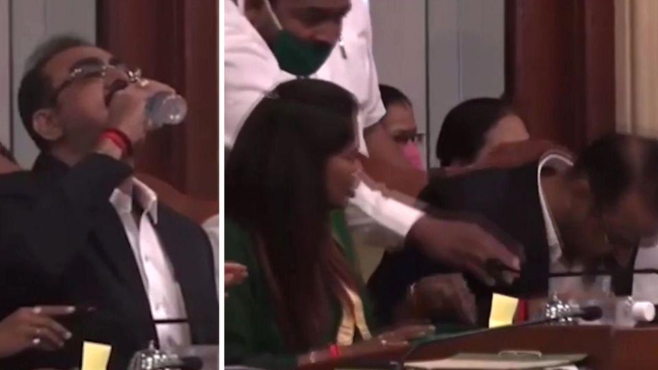 Beamter trinkt bei Sitzung Desinfektionsmittel
