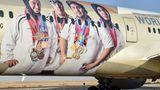Im hinteren Teil des Rumpfes einer Boeing 787 von Etihad zieren vier Sportler, die bei den Special Olympics World Games im Frühjahr 2019 für die Vereinigten Arabischen Emirate antraten.