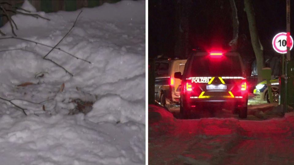 Links ist eine zerwühlte Stelle im Schnee zu sehen, an der das Baby gelegen hat, rechts zwei beleuchtete Polizeiautos im Dunkeln