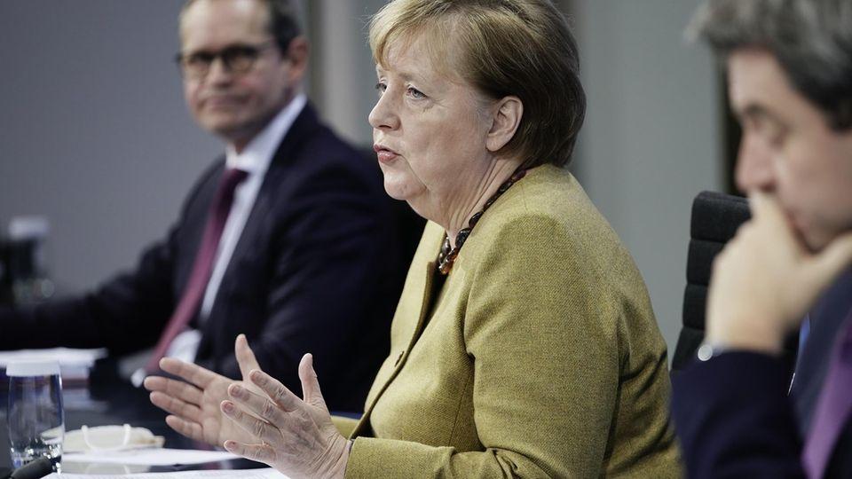 Michael Müller (SPD), Angela Merkel (CDU) und Markus Söder (CSU)