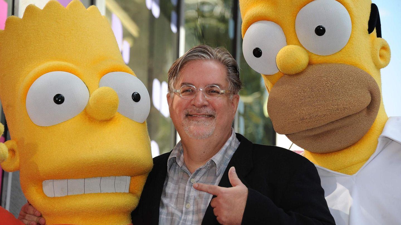 Matt Groening mit den von ihm erschaffenen Figuren Bart (l.) und Homer Simpson
