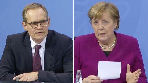 Michael Müller und Angela Merkel
