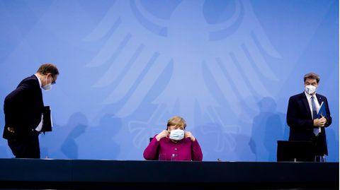 Michael Müller, Angela Merkel und Markus Söder nach den Beratungen zum Coronavirus