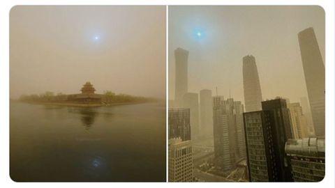 China: Sandsturm färbt Himmel über Peking gelb und die Sonne blau