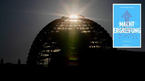 """Die Sonne geht hinter der Kuppel des Reichstagsgebäudes auf. Rechts oben:Der Einband des Buches """"Machtergreifung"""""""