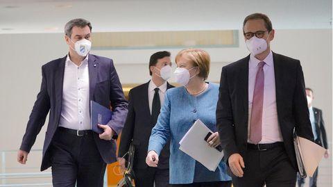 Angela Merkel, Markus Söder, Michael Müller