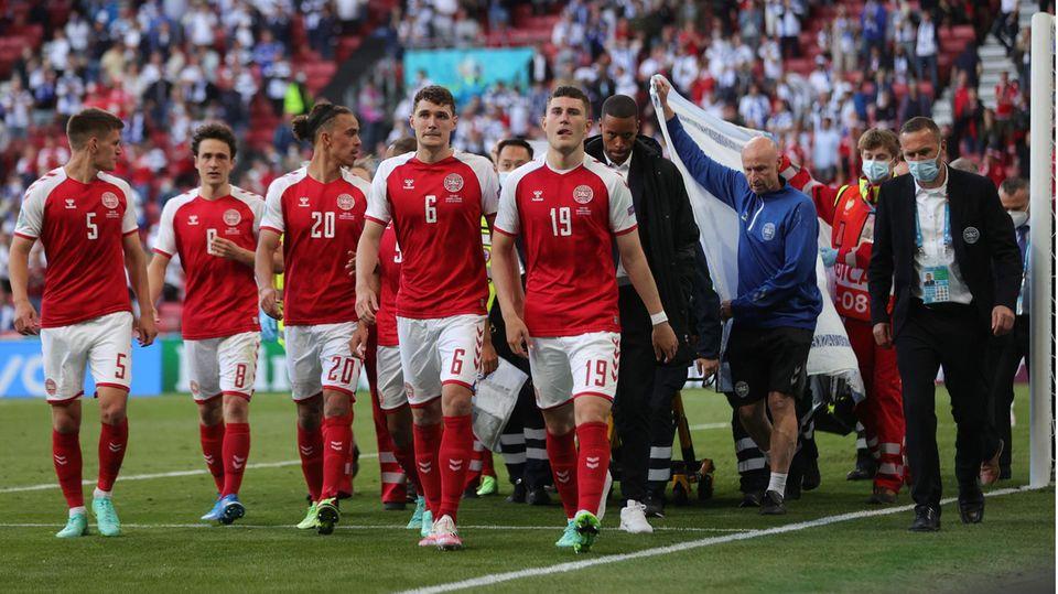 Dänemark-Spieler nach dem Kollaps von Christian Eriksen