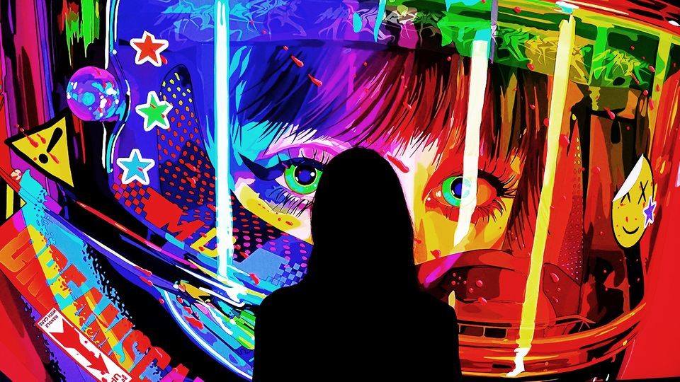 Woman stands in front of digital artwork