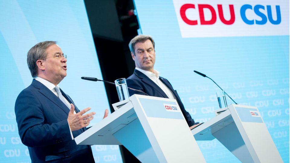 Armin Laschet (l.), Kanzlerkandidatund CDU-Bundesvorsitzender,und Markus Söder, CSU-Vorsitzender