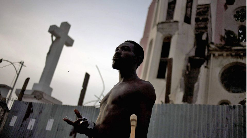 Man in front of church in Port-au-Prince