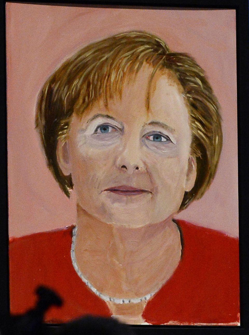Ein Porträt von Angela Merkel, gemalt von George W. Bush