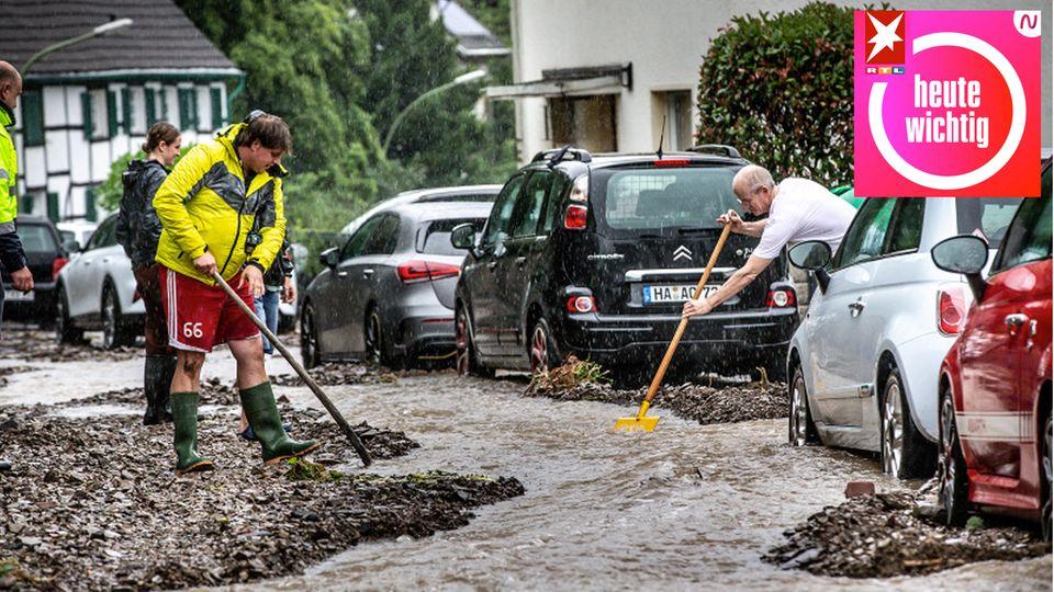 Anwohner beseitigen Flut-Chaos