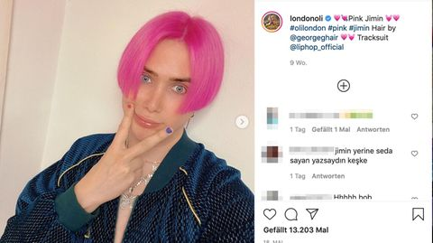 Ein junger Mann mit pinken Haaren posiert für ein Foto
