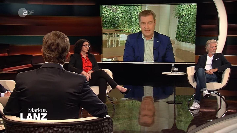 Markus Söder war bei der Sendung von Markus Lanz (v.) zugeschaltet