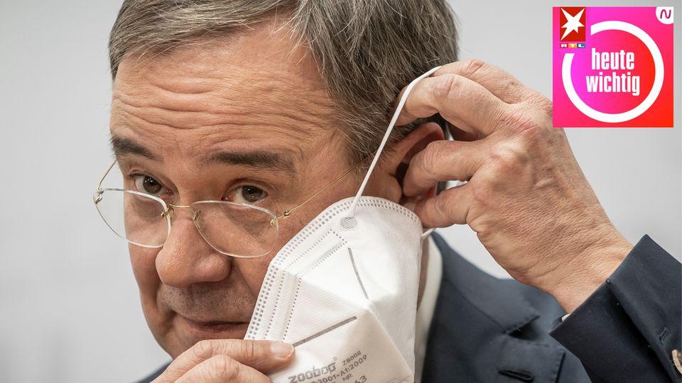 CDU-Kanzlerkandidat legt sich eine FFP2-Maske an