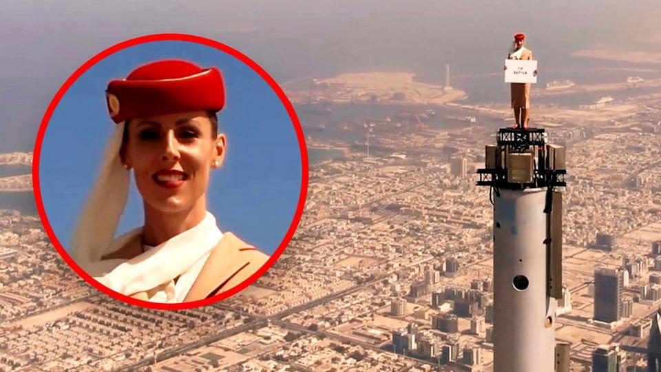 Burj Khalifa: Stewardess steht auf dem höchsten Gebäude der Welt.