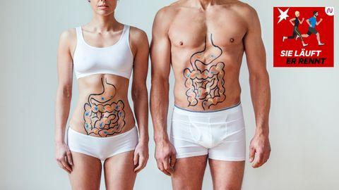 Eine Frau und ein Mann mit auf dem Bauch gemalten Verdauungsorganen