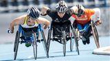 """Merle Marie Menje (l.), Leichtathletin. Behinderung: Spina Bifida. Nach ihrem sehr erfolgreichen Debüt bei den Europameisterschaften bezeichnete sie das Internationale Paralympische Komitee als """"German Wunderkind"""". Sie gewann bei der EMzwei Goldmedaillen (Rennen über 400 und 5000 Meter) und zwei Silbermedaillen (über 100 und 800 Meter)."""