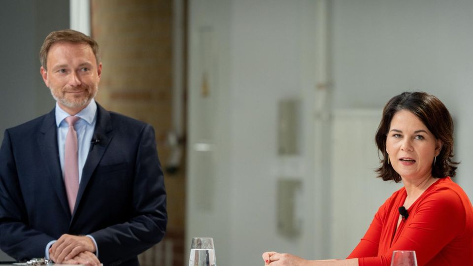 Ihre parteien werden höchstwahrscheinlich zum Königsmacher: FDP-Chef Christian Lindnerund Grünen-Spitzenkandidaten Annalena Baerbock