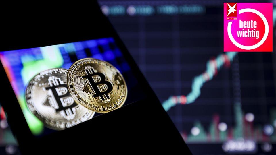 Eine Bitcoin-Illustration auf dem Bildschirm eines Smartphones