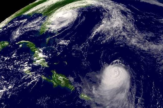Die Cayo Ernesto Thaelmann liegt auf dem 81. Längen- und 23. Breitengrad in der Karibik vor der Südküste Kubas - im wolkenfreien Teil der Insel in der linken Bildhälfte