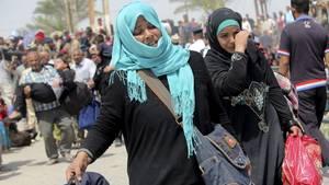 Terror-Flüchtlinge im Irak: Zwei Frauen fliehen in der Nähe von Bagdad vor den IS-Truppen