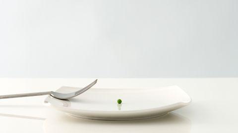 Veganerin: Ein Teller mit einer Erbse