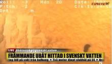 In einem Standbild aus einem Tauchvideo ist der Rumpf eines U-Bootes zu sehen, der kyrillisch beschriftet sein könnte
