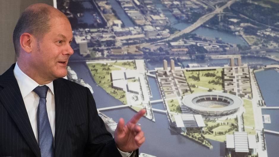 Hamburgs erster Bürgermeister Olaf Scholz vor einer Visualisierung des Olympiaparks in Hamburg