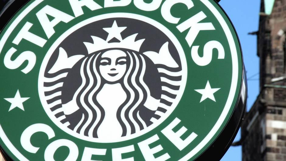 Das grüne Starbucks-Logo mit der schwarzen Nixe