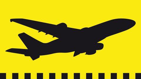 Ein schwarzes Flugzeug auf gelbem Hintergrund