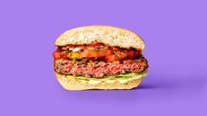Ein vegetarischer Burger, der aussieht wie Fleisch.
