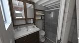 Das Badezimmer ist modern und funktional gestaltet.