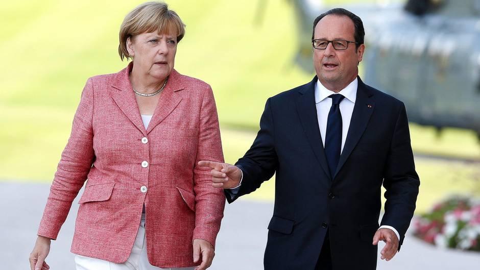 Bundeskanzlerin Angela Merkel und der französische Präsident Francois Hollande stehen hinter den USA