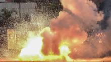 In Venezuela explodiert eine Tränengasgranate der Polizei bei Protesten gegen Präsident Nicolás Maduro