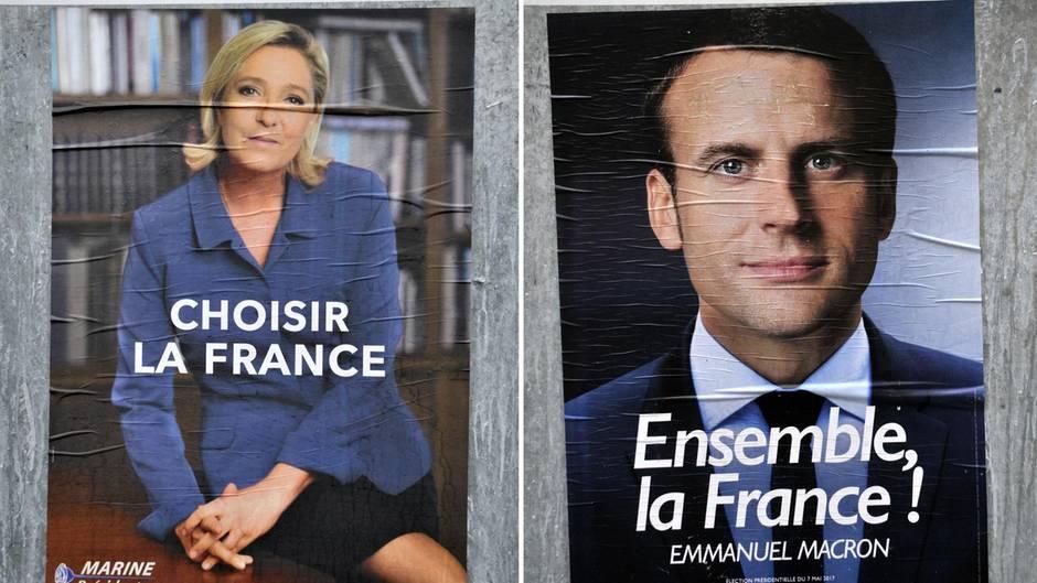 Wahlplakate von Marine Le Pen und Emmanuel Macron: Angela Merkel hat einen klaren Favoriten für die französische Präsidentschaft