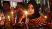 Indien: Ein junges Mädchen nimmt an Protesten für härtere Strafen für Vergewaltiger teil.