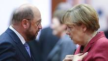 Martin Schulz und Angela Merkel stehen sich gegenüber