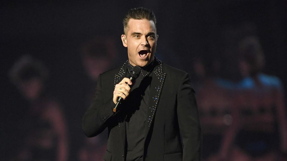 Auch Robbie Williams will mit seiner Stimme helfen, Spenden für die Opfer des Grenfell-Tower-Brands zu sammeln