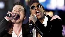 Sänger Wiz Khalifa und Charlie Puth performen einen Song. Ihr Youtube-Video begeistert Milliarden.