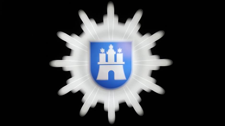 Ein Hamburger Polizeiwappen: Betrüger haben sich in der Hansestadt als Beamte ausgegeben und Senioren bestohlen