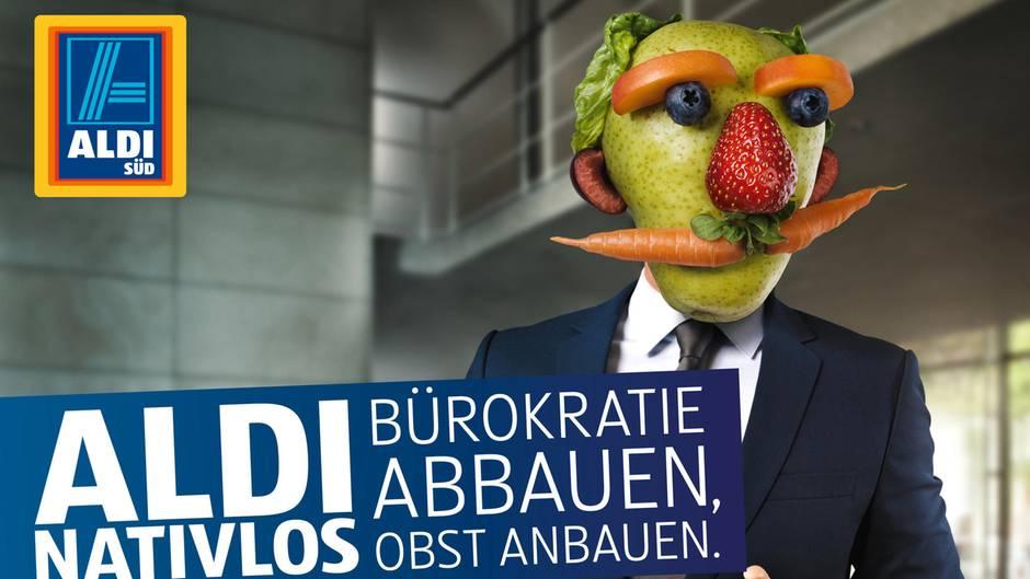 Ein Plakat der Aldi Süd Werbekampagne zeigt einen Mann im Anzug, sein Kopf besteht allerdings aus Obst und Gemüse