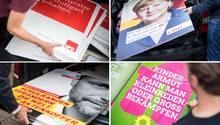 """Wahlkämpfer der Parteien SPD, der CDU, der FDP und der Partei """"Bündnis 90/Die Grünen"""" Plakate ihrer Partei für das Aufhängen vor."""
