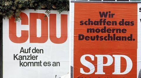 Mit Plakaten und Programmen gehen CDU und SPD im Bundestagswahlkampf auf Stimmenfang (Archivbild)